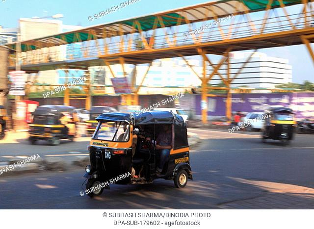 Auto rickshaw speeds on the road at Bandra Mumbai Maharashtra India Asia