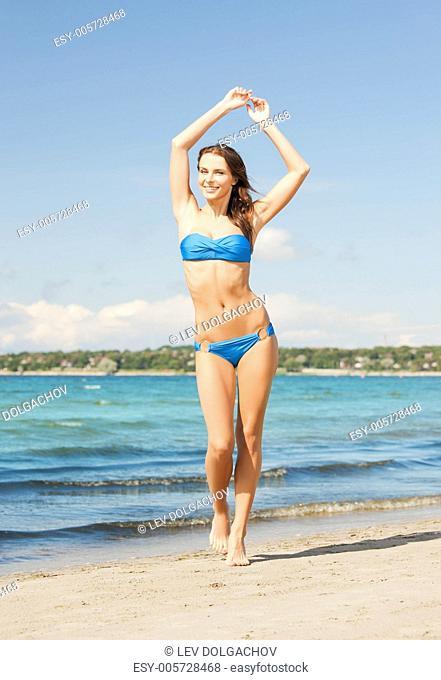 picture of beautiful woman in bikini smiling