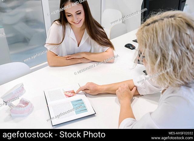 Dentist explaining treatment to patient