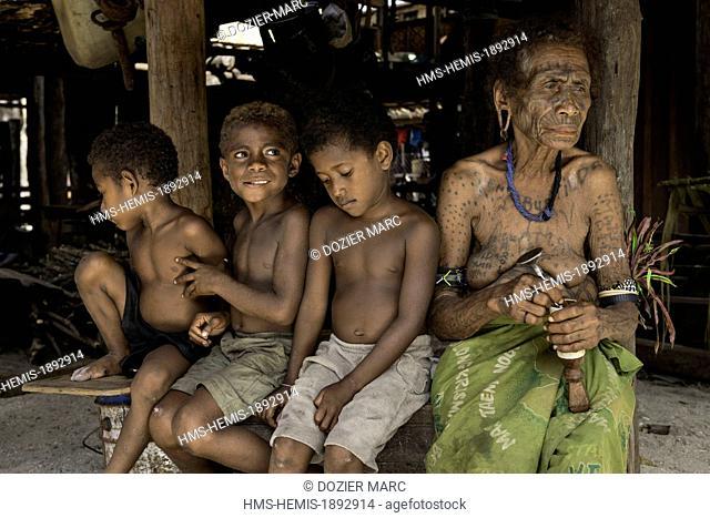 Papua New Guinea, New Britain island, West New Britain province, Talasea district, Kimbe area, Kapo island, Anthonia Mondo with traditional tatoo