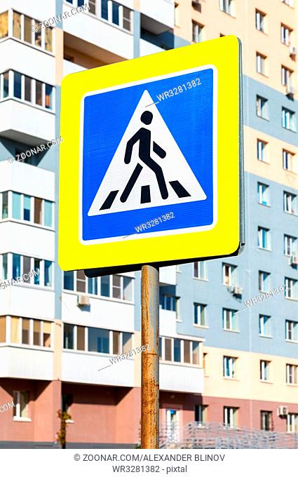 Road sign Pedestrian crossing against the apartment house