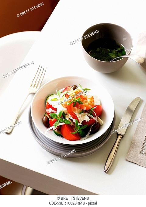 Plate of horiatiki salad with prawns
