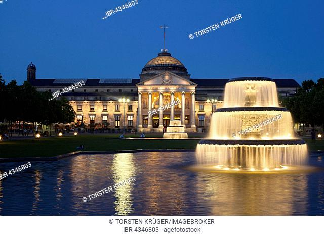 Spa hotel with fountain and park Bowling Green at dusk, Wiesbaden, Hesse, Germany