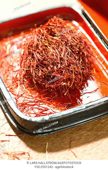 Saffron in a red laquer box. Close up of spice. Concept of culinary cooking