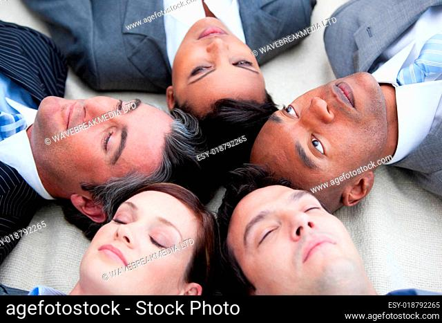 Close-up of relaxed business team lying in circle