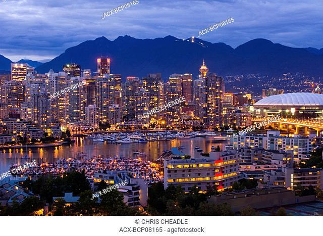 BC Place Stadium and False Creek at dusk, British Columbia, Canada