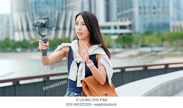 Woman taking a vlog on mobile phone in Shenzhen city