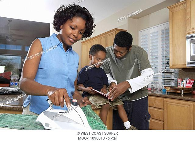 Family with son 3-6 in kitchen