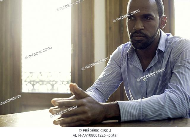 Businessman listening attentively during meeting