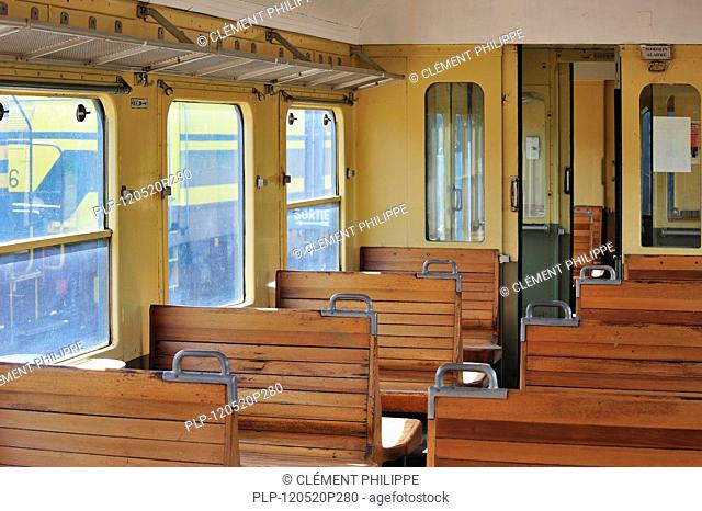 Old passenger carriage with wooden benches at the depot of the Chemin de Fer à Vapeur des Trois Vallées at Mariembourg, Belgium