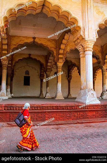 Local woman walking near Hall of Public Audience in Agra Fort, Uttar Pradesh, India. The fort was built primarily as a military structure