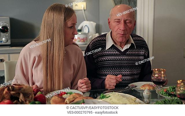 Family having dinner together on Thanksgiving