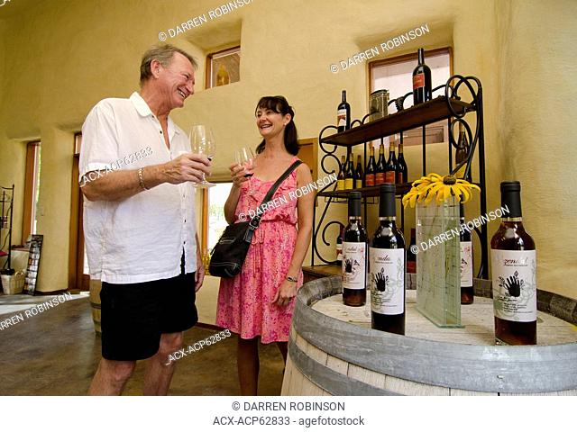 Couple samples some tasty wine in the tasting room of Orofino winery in Keremeos, in the Similkameen region of British Columbia, Canada