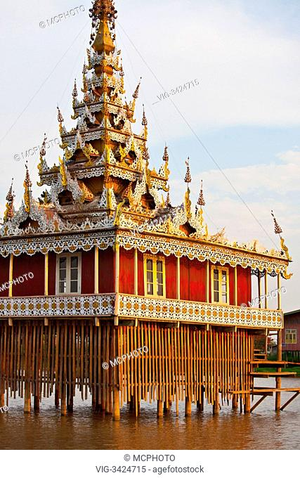 A BUDDHIST TEMPLE is built on stilts the village of PWE SAR KONE - INLE LAKE, MYANMAR - 26/04/2012