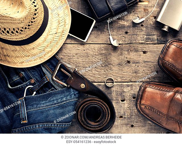 Vintage color toned travel background with clothing and camera on a wooden table