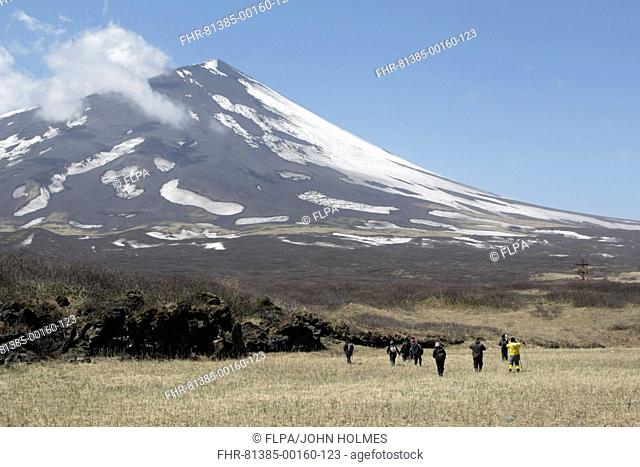 View of tourists and volcano, Mount Alaid, Atlasova Island, Kuril Islands, Sea of Okhotsk, Sakhalin Oblast, Russian Far East, Russia, june
