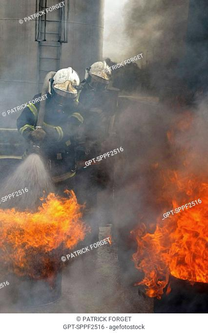 FIREFIGHTERS IN ACTION TO EXTINGUISH FIRES IN BARRELS OF HYDROCARBON, DEPARTMENTAL FIREFIGHTERS' SCHOOL OF THE SDIS61, ALENCON, ORNE 61, FRANCE