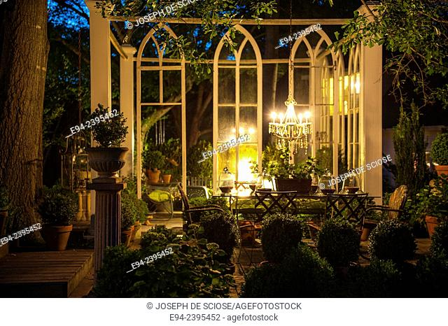 Outdoor living space in a garden setting at twilight. Georgia USA
