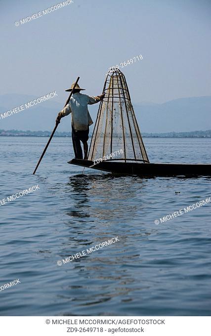 A traditional leg rowing fisherman on Inle Lake