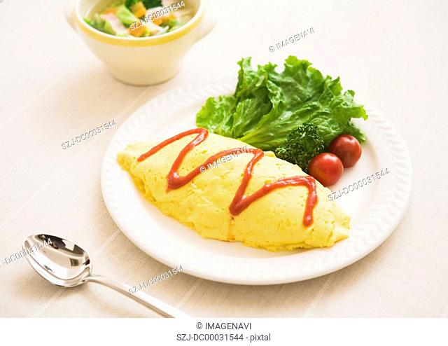 Omelet with a Filling of Ktchup-Seasoned Fried Rice