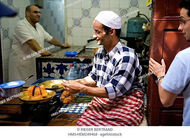 Morocco, Middle Atlas, Fez, Imperial City, Fez El Bali, medina listed as World Heritage by UNESCO, preparing fritters