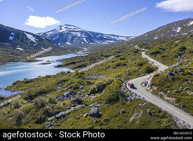 Aerial view, VW bus on road, Turquoise lake and mountains, Norwegian Landscape Route, Gamle Strynefjellsvegen, between Grotli and Videsæter, Norway, Europe