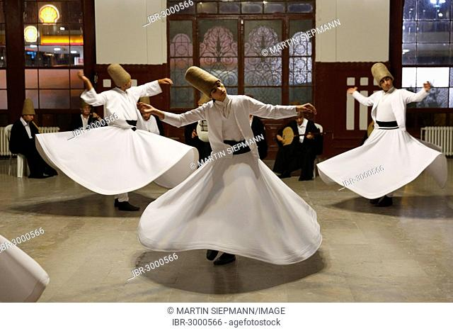 Whirling Dervishes dancing the Sema, a Dervish dance, Sirkeci Railway Station, Istanbul, Turkey, Europe