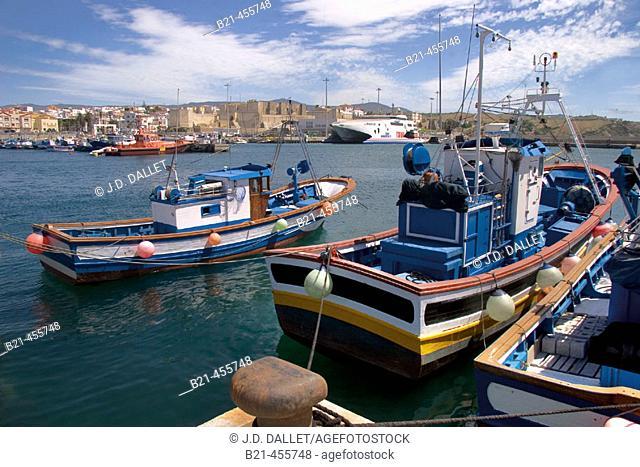 The harbour of Tarifa and back the moorish castle. Cádiz province. Andalucia. Spain