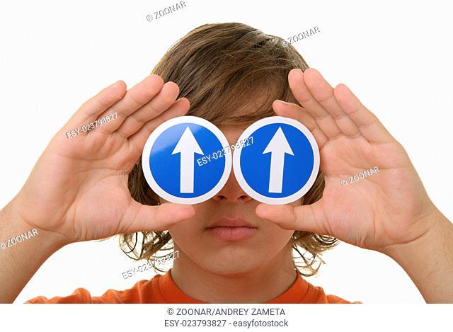Teenager holds before arrow eyes specifying upward