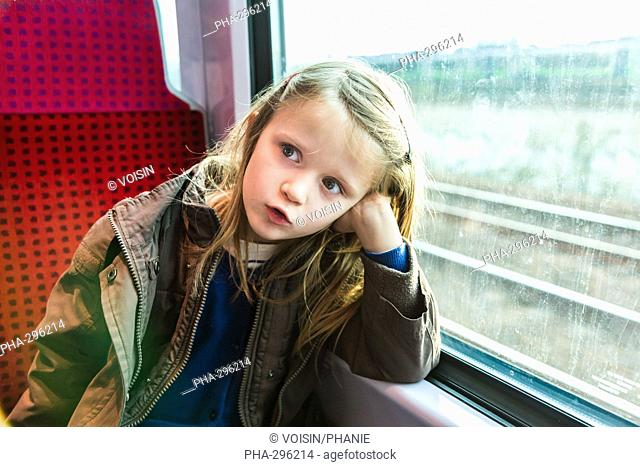 5 year old girl in a train