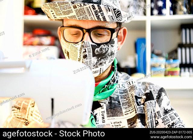 April 23, 2020, Berlin, Berlin, Germany: Italian hatter GIUSEPPE TELLA can be ssen waering a face masks behind a sewing machine in his studio in Berlin
