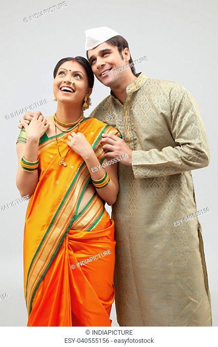 Maharashtrian couple looking at something