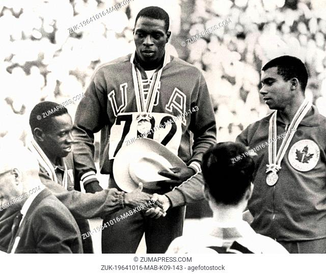 Oct. 16, 1964 - Tokyo, Japan - American runner BOB HAYES, born Robert Lee Hayes, on the rostrum wearing his gold medal as he watches the Cuban ENRIQUE FIGUEROLA...
