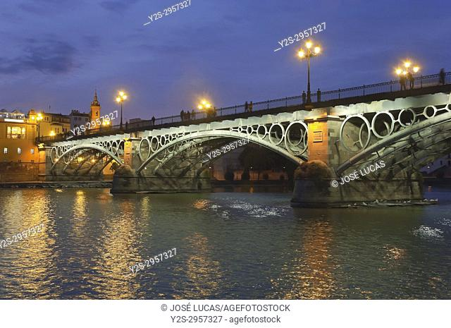 Triana bridge and Guadalquivir river at dusk, Seville, Region of Andalusia, Spain, Europe