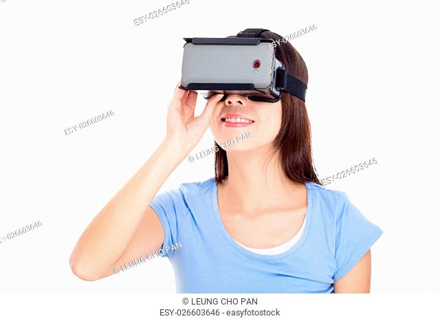 Woman looking though virtual reality goggle