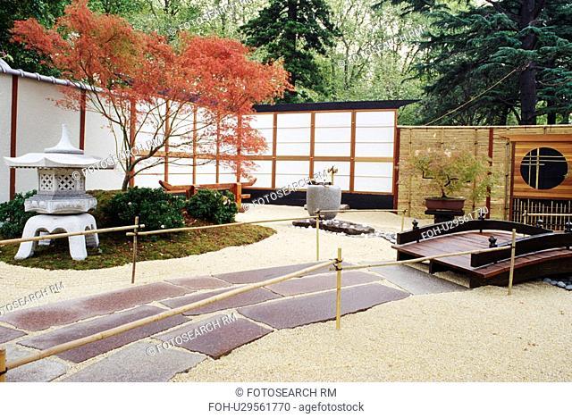 Oriental style enclosed garden with bridge and lantern