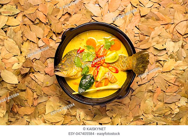 white snapper fish curry soup with tomato, red chilli, and lime leaf, Top view