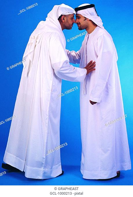 Nose traditional greeting stock photos and images age fotostock arab men rubbing their noses traditional greeting m4hsunfo