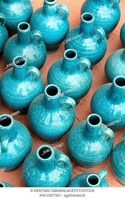 Earthern jars in turquoise color on the floor of a shop, Yazd, Iran, Asia