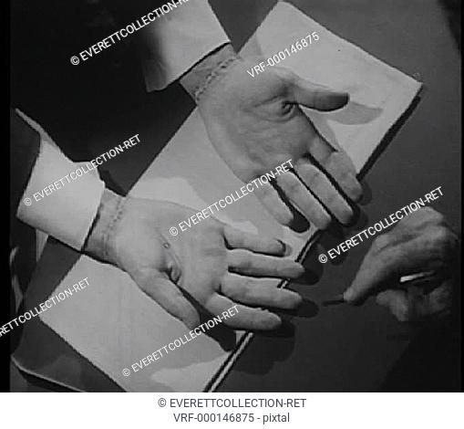 Doctor testing feeling in injured man's hands