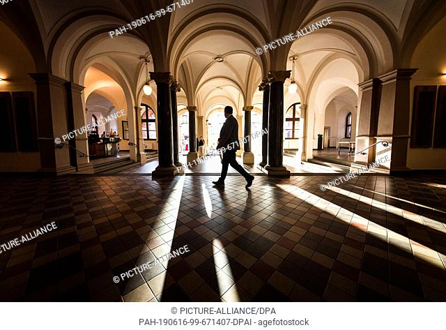 16 June 2019, Hessen, Wiesbaden: A man walks through the city hall foyer in the state capital. According to the preliminary official result
