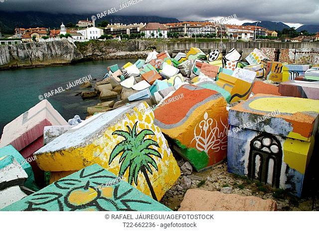 'Los Cubos de la Memoria' by sculptor Agustin Ibarrola in the seaport, Llanes. Asturias, Spain