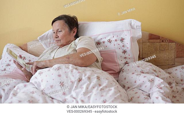 Senior woman using digital tablet in bed