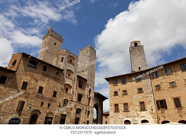 Buildings and towers overlooking Piazza della Cisterna, San Gimignano, Siena, Tuscany, Italy, Europe