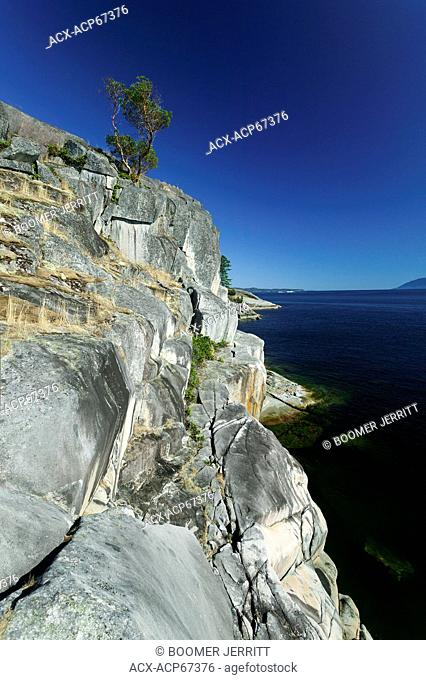 Stillwater Bluffs a local climbing area boasts clean granite cliffs that rise out of the sea just south of Powell River. Powell River, The Sunshine Coast