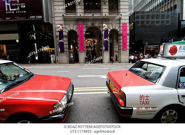 Taxis await passengers in downtown Hong Kong