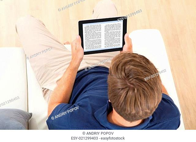 Man Reading eBook At Home