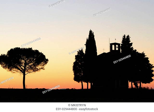silhouette of famous Chapel of the Madonna di Vitaleta in Tuscany, Italy