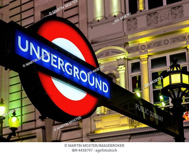 Illuminated Underground sign, evening, Piccadilly Circus, London, England, United Kingdom