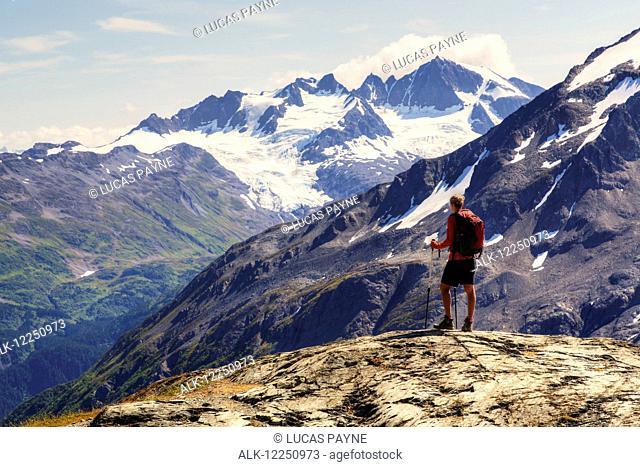 Female backpacker enjoying the view from the Harding Icefield Trail near Seward, Kenai Fjords National Park, Kenai Peninsula, Southcentral Alaska, Summer, HDR
